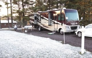 Picture of RV with a little snow on the ground at Cool Breeze Campground