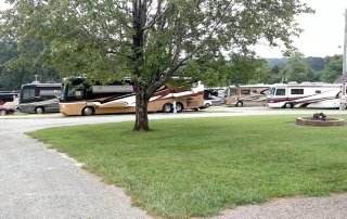 RVs lined up next to Cool Breeze Campground sign