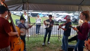 Kids playing Bluegrass music under the tent