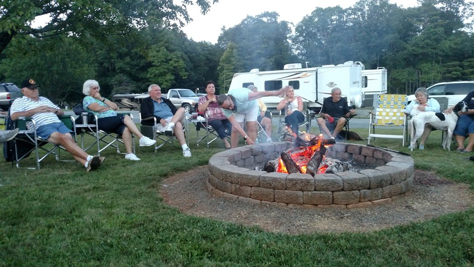 Group of people and a dog enjoying the firepit